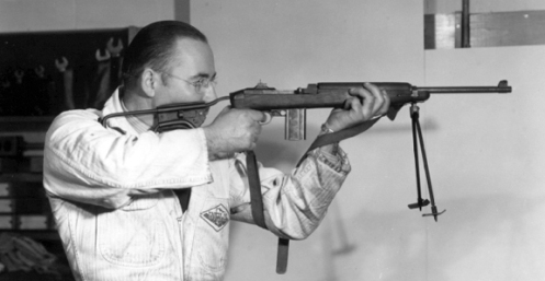 A worker at SAL test firing the M1 carbine. MilArt photo archives