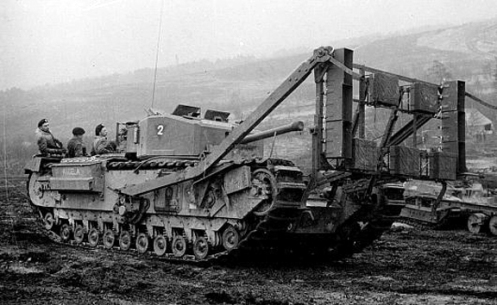 "A right-side view of ANGELA, showing the right-side arm, attached to a bracket which supported the vertical ""Onion"" explosive device framework on the tank's front. Note also, the two outward facing legs, attached to either corner of the top of the framework. Source: authors' collection."