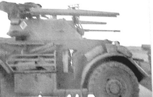 Photographs from First Canadian Army's Weapons Technical Staff Officer Major Sangster's report showing the rails fitted to a XII Manitoba Dragoons Staghound.The vehicle bares the tac sign of the HQ Company]