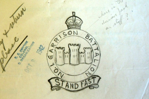 "Initial drawing for the 1st battalion badge. A pencil notation asked ""where is the Union Jack on staff?"" Although Lt-Col Carmichael commands the '1st' Garrison Battalion he has incorrectly used the naming convention 'No.1'."