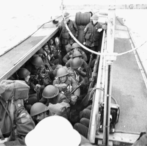 Infantrymen of Le Regiment de la Chaudiere alongside HMCS Prince David, off the coast of England, 9 May 1944.