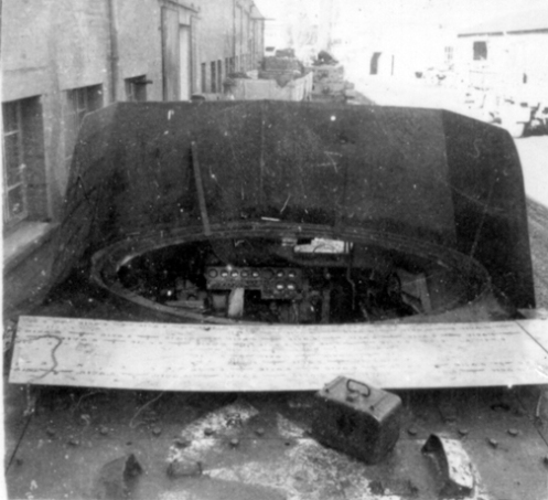 A mock-up of the proposed two-foot (one-metre) high shield, which fit around the forward edge of the circular opening in the Ram Kangaroo hull top, that was devised by No. 2 Canadian Tank Troops Workshop, Royal Canadian Electrical and Mechanical Engineers, and was inspected by the regiment's second-in-command, Major Bingham, on 27 October 1944, but was never adopted. MilArt photo archives