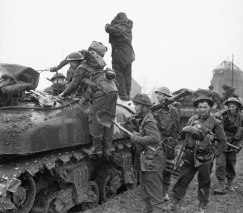 Infantrymen of the British 3rd Infantry Division loading onto Kangaroos of the 49th Armoured Personnel Carrier Regiment, Royal Armoured Corps, prior to an attack on Kervenheim, Germany, 2 March 1945.  Source: Imperial War Museum (B 14972)