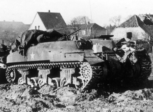 A 'Ram' Kangaroo armoured personnel carrier of the 1st Canadian Armoured Personnel Carrier Regiment. Note the forward facing secondary .30-calibre Browning machine gun mounted in the turret ring, and the vehicle tarpaulin, which as been pulled back from over a 'tarp/bivouac' support, which can be seen with one leg mounted in the front of the turret ring, while the other leg is mounted in the rear of the turret ring, with the centre pole of the  'tarp/bivouac' support, in between. Source: 1 CACR Association & Archive