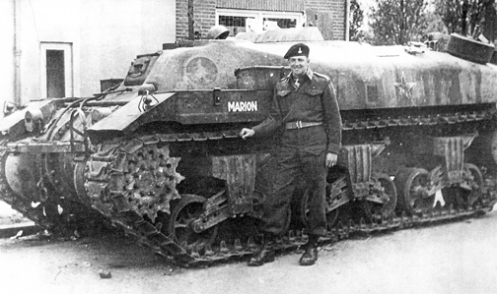 "One of the 'Ram' armoured ammunition carriers issued to 1st Canadian Armoured Personnel Carrier Regiment, as a 'command' carrier, bearing the name MARION (CT159891), seen here, in June 1945, as the 'Kangaroo' of  Major W.A. Copley, Officer Commanding, ""B"" Squadron, which he named after his wife Marion. Just above Major Copley's head, on the top of the hull, can be seen, the 7-inch (18-centimetre) high, splash plate, which was installed around the 28-inch (71-centimetre) square double hinged hatches, in the centre of the circular armoured plate that was placed over the turret ring, as described in the text. Source: Bill Miller"