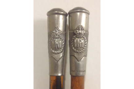 "Two swagger sticks of The RCR with the proper Regimental Crest. Although similar in construction, the stick on the right has a ""Made in England"" stamp."