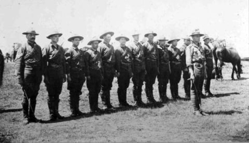 "Lieutenant Lionel F. Page and members of his troop of the Red Deer Independent Squadron of the 15th Canadian Light Horse on manoeuvres at Sarcee Camp near Calgary, Alberta. Lance Corporal Caswell is 11th from left. Inscribed in pencil on verso: ""Page's troop"". Circa 1910"