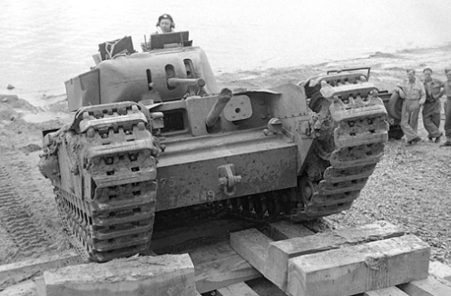 A Churchill Mark I of the Calgary Regiment training on a beach near Seaford, Sussex, in July 1942. Source: MilArt photo archives.