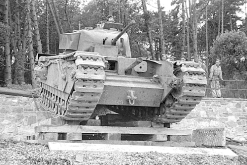 A Churchill Mark I of the Calgary Regiment, note the placement of the 3-inch howitzer in the front hull plate. Source: MilArt photo archives.