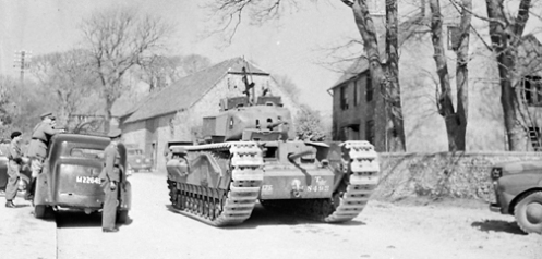 A Churchill Mark I of the Calgary Regiment, note the Bren light machine gun in its anti-aircraft mounting on the turret roof. Source: MilArt photo archives.
