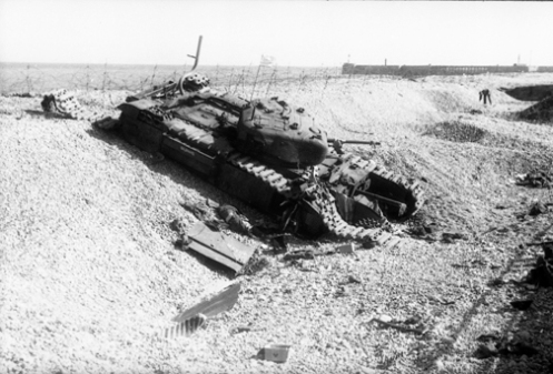 "A reworked Churchill Mark I of the Calgary Regiment's ""B"" Squadron Headquarters knocked out at Dieppe. Source: Authors' image file."