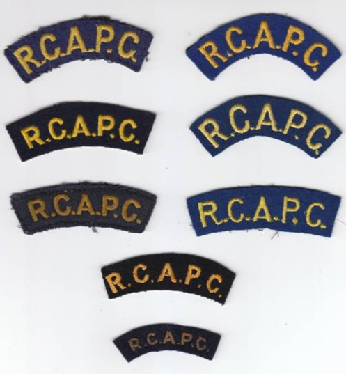 Several varieties of R.C.A.P.C. abbreviated titles. Primrose yellow was open to interpretation, as can be seen in the different colours of embroidery. The bottom title is made in bullion wire. Authors collection.
